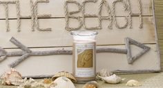 Our Footprints In The Sand Jewelry Candle recreates the ultimate beach experience with this nostalgic floral blend. Fresh orange sweetens the heart of blooming jasmine and shimmering orange flower as warm woods surround the summer floral accord with warmth.    Inside every candle is a hidden jewe...