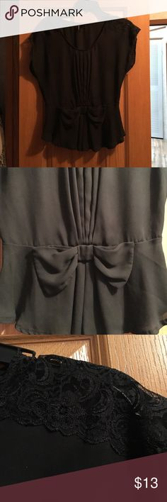 Black dressy blouse Black flowy blouse. Cinched waist with bow. Shoulders has see through lace. Tops Blouses