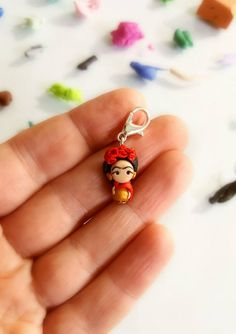 Frida inspired charm - red flower - frida inpired jewelry - clay charms Each object is modeled by hand and is unique, it can then differentiate themselves from the object in the picture in some detail. Small differences that guarantees the craftsmanship of the object but that does