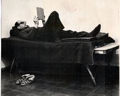 Relaxing: Adolf Eichmann pictured reading a book on his bed in his cell