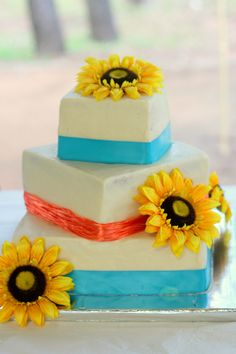 sunflower, turquoise, coral wedding cake done by my amazing friend from high school :)