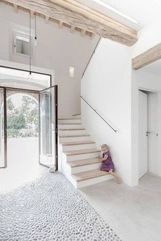 Like the stairs and the colour of the beam, not the cobble stones