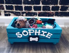 Keep all those ropes, balls, and chew toys in one handy place with this Rustic Dog Toy Box. This hand-crafted box is made from pine and given a hand-painted matte chalk bright blue finish for lasting durability. Each box is customized so that your dogs na Dog Toy Storage, Stuffed Animal Storage, Toy Storage Boxes, Toy Bins, Diy Stuffed Animals, Small Dog Toys, Diy Dog Toys, Cat Toys, Small Dogs