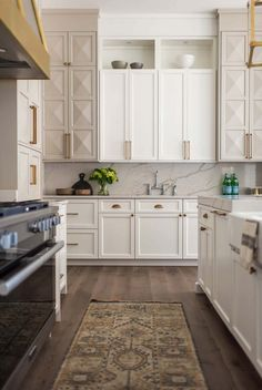 Obsessed with the pyramid shape of these kitchen cabinet doors. Such a fresh take on the white kitchen.