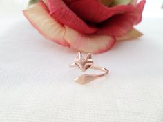 Hey, I found this really awesome Etsy listing at http://www.etsy.com/listing/152944226/rose-gold-fox-ringadjustablestacking