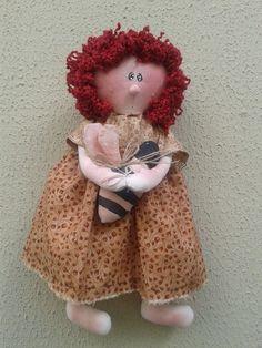 Boneca com abelheira