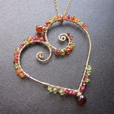 """Hammered heart wrapped with peridot, citrine, orange sapphire, and pink tourmaline, about 18"""" long with 2"""" heart.  Featured in The Crafts Report Magazine  Matching Earrings - https://www.etsy.com/listing/127835895/luxe-bijoux-56-hammered-hearts-wrapped  Available in 14k gold filled & sterling silver"""