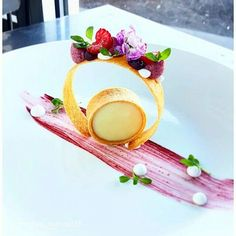 Valrhona Opalys white chocolate-coconut tartlet with cherry foam, honey tuile, and coconut gel