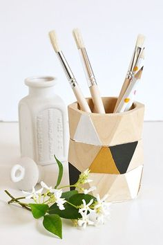 Wood Bangle Pencil Cup By Make And TellInstead of tossing out those wooden bangles that just can't seem to stay on your wrist, turn them into a chic, geometric pencil holder with this easy hack. #refinery29 http://www.refinery29.com/back-to-school-diy#slide-4