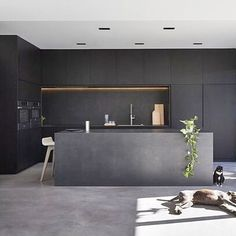 All black kitchen designed by @dko_architecture, photo by Peter Bennetts #dkoarchitecture #interiordesign