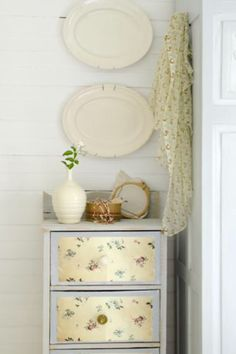 """This decorated cupboard with wallpaper is from our feature """"Riverside Idyll"""""""