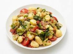 Gnocchi with Bacon and Escarole : With just 10 minutes' prep time, this pasta dinner comes together quickly, thanks to quick-cooking bacon and escarole. via Food Network