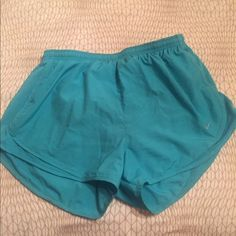 Nike shorts size L Light blue shorts that have never been worn! Super pretty color just no shirts to go with! Willing to trade so just ask! Nike Shorts