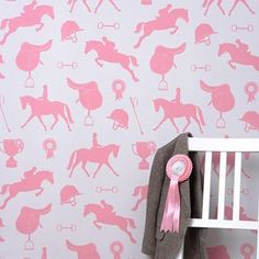 Buy online Hibou Homes Gymkhana Girls Wallpaper in Coral Pink, is a sophisticated equestrian theme. Gymkhana wallpaper is every horse and pony lovers dream.