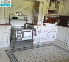Casa:1 | Hier macht Kochen doppelten Spaß. In dieser geschmackvollen Küche einer Kundin in Nottuln (Kreis Coesfeld) wurden einfarbige Casa:1 #Zementfliesen (SOL200), schlichte Motivfliesen (FIN014) und ein passender Rand (RAN005) verwendet. www.casa1-zementfliesen.de