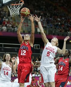 Diana Taurasi grabs a rebound against Czech Republics's Michaela Zrustova during their women's basketball game on Day 7.
