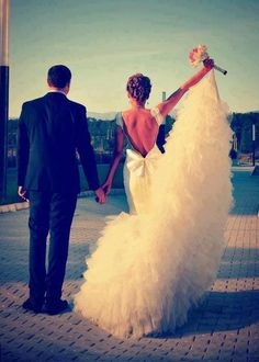 gorgeous wedding dress- love the open back and bow