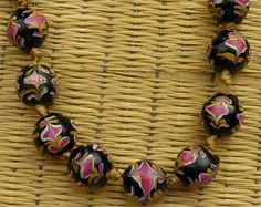 This is a exquisite set of super-rare Venetian trade beads. These beads are in amazingly good condition and have been lovingly strung on thick satin cord and knotted between every bead. Did we mention