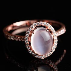 simple designer sparkling halo blue moonstone promise ring in rose gold