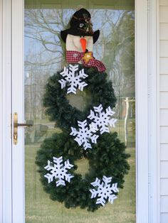Too cute. Just when you put the holiday Wreaths away... out comes the snowman for the winter!