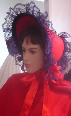 Offered for sale is a Beautiful custom handmade bonnet head dress to match your costumes for Civil War,Victorian, Dickens, Re enactments,Red Hat Society,Halloween,and more.We are showing a red with purple trim bonnet. I make this bonnet in many other colors with a variety of lace trims.The bonnet fits most adult sized heads. The base color is red. We use purple chantilly lace trim and red ribbon tie sashes. A velvet suede border in a deep plum adds the finishing touch. We use pellon…