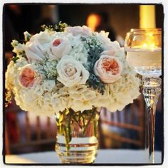 Vintage floral arrangement. Garden roses, hydrangea, roses, dusty miller and baby breath. Florals by www.luxuriousevent.com