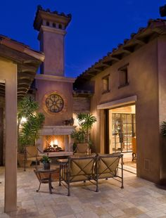 Functional Outdoor Fireplace Designs in Your Backyard: Mediterranean Patio In Outdoor Artistic Fireplace Design Equipped With Tall Brick Chimney Accented By Clay Like Colour Wall And Roof Decorated By Palm Like Plants Also Sets Of Outdoor Furniture Courtyard Design, Patio Design, Tuscan Courtyard, Courtyard Ideas, Outdoor Rooms, Outdoor Living, Outdoor Decor, Outdoor Seating, Outdoor Patios