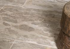 A unique, antiqued marble with tones of taupe, brown, ecru and grey throughout.