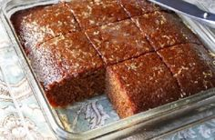 Silver Palate Gingerbread with Warm Lemon Sauce.Silver Palate Gingerbread **I make it with Einkorn flour, coconut sugar in place of white, and sometimes dark chocolate chips instead of the lemon glaze! Food Cakes, Cupcake Cakes, Cupcakes, Cakes Made With Oil, Lemon Glaze Cake, Silver Palate Cookbook, Cake Recipes, Dessert Recipes, Martha Stewart Recipes