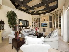 Cream and gray grey family room - dark ceiling beams and grasscloth ceiling detail.  The Moorings | Naples, Florida