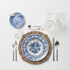 Verona Chargers in Walnut + Blue Garden Collection Vintage China + Axel Flatware in Matte Silver + Vintage Cut Crystal Goblets + Early American Pressed Glass Goblets + Vintage Champagne Coupes + Antique Crystal Salt Cellars  SHOP:Verona Chargers in Walnut