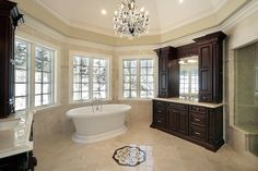 """This first bathroom is all Crema Marfil marble from the floor and wall tile to the slab vanity countertops. The edge detail on the vanities looks like it's a 1 1/2"""" Double Ogee."""