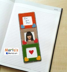 Felt bookmark with 3 frames where you can insert photos, messages and quotes on the side.