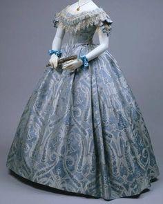 Light blue off-shoulder gown with lace trim
