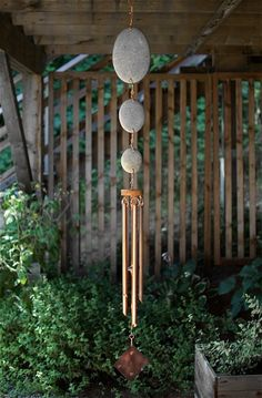 Inspired by nature, this wind chime has 3 large smooth and rounded natural beach stones, 5 copper chimes, and a beach stone clapper. This wind chime measures 54 inches long from the top of the copper