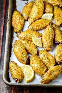 CRISPY Baked Lemon Pepper Chicken Wings! FOUR ingredients, so much FLAVOR! Double the batch, they go FAST!