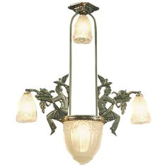 An Art Deco Chandelier -- With Ladies | From a unique collection of antique and modern chandeliers and pendants  at http://www.1stdibs.com/furniture/lighting/chandeliers-pendant-lights/