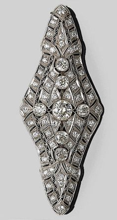 A diamond pendant-brooch  centering an old European-cut diamond, weighing approximately: 1.00 carat; remaining diamonds weighing 3.75 carats; mounted in platinum. Edwardian or Edwardian style.