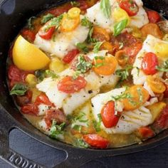 Healthy and easy pan seared halibut fillets in a lemon garlic white wine sauce, with heirloom cherry tomatoes and fresh basil.