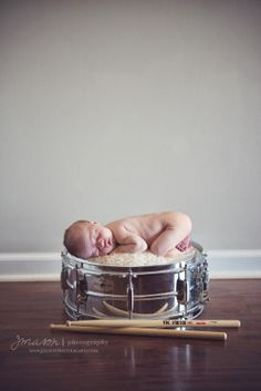 Newborn Daughter On Snare Drum.... This will totally be Aaron's baby!