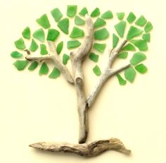 Doesn't this tree say Spring? A creative sea glass art idea that includes a few driftwood sticks. Driftwood and sea glass pieces are glued to a canvas. Sea Glass Beach, Sea Glass Art, Stained Glass Art, Sea Glass Jewelry, Fused Glass, Clear Glass, Wine Glass, Cool Ideas, Diy Ideas