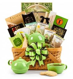 Traditional Teatime Basket: Coffee & Tea Gift Baskets - A tea-themed basket that overflows with five types of premium teas & a tasty selection of delicious treats.