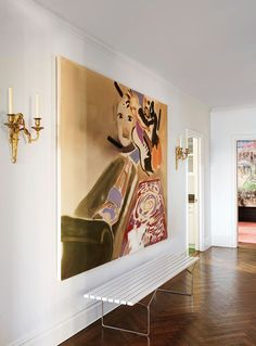 A painting by Sophie von Hellermann is displayed above a Harry Bertoia bench in the entrance hall of perfumer Frédéric Malle's New York apartment.