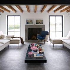 Interiors / White and grey living / Concrete floor / Blue Chair