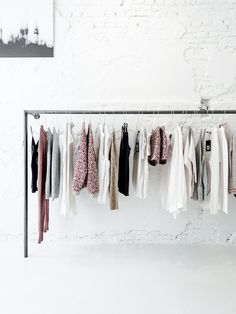 concept store cottoncake amsterdam hotspot clothing rack white grey and pink clothes soft colours