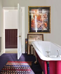 A vintage tub boasts a bold red exterior hue.