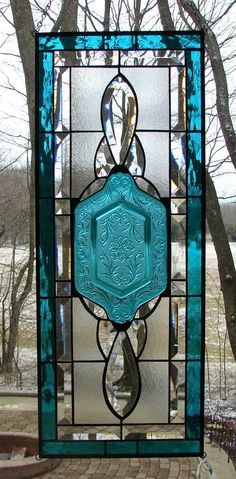 Ilove this woman's work. She finds old glass plates and upcycles by building a stained glass panel around them.