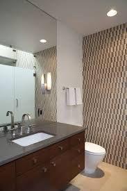 Resultado de imagen de bathroom with grey tiles and dark wood