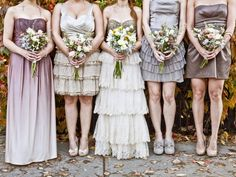 Stunning mismatched mauve, purple and gold bridesmaids' dresses.