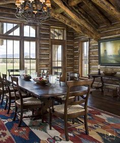 Rustic yet beautiful dining room in the Montana log home.  If that colorful rug wasn't on the floor, this would be a very mono-chromatic room...